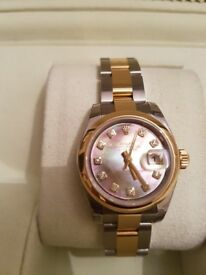 Rolex Ladies DateJust Mother of Pear 10 diamonds