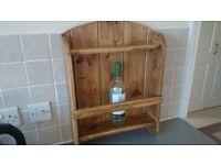 Rustic wall mounted wine bottle holder.