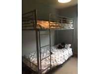 Metal bunk bed frame.