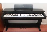 Yamaha Clavinova / digital piano / electric piano CLP124 Feels like a real piano but needs no tuning