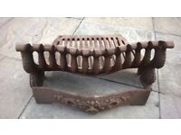 Cast Iron Fire Grate. 18 inches wide by 8 inches high.