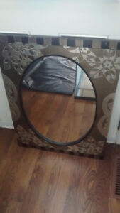 "Oval-shaped wall mirror with 32"" by 24"" frame - great condition"