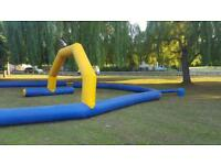 Inflatable quad track with petrol blower