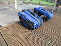 A pair of Oxford Sports Lifetime Luggage expandable humpback panniers in blue