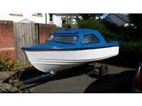 12-13 foot fibreglass Boat with trailer.