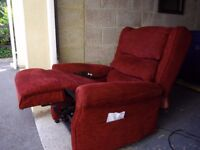 Suite. an electric riser recliner chair + matching 2 seat sofa. two items an armchair + settee