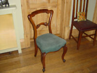 four dining chairs in walnut. Cabriolet legs and very sturdy.