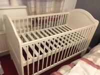 Cot also turns into joiner bed size 70cm X 140cm