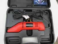 Electric scraper with tools complete in carry case.