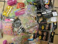 Large collection of loom bands and accessories.
