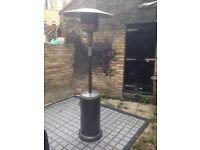 Outdoor patio heater hardly used for sale including cover and almost full gas