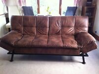 Texas faux leather sofa bed, as new. (Benson for Beds)