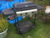 Gas BBQ - two burners working. With gas bottle