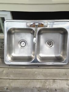 Double sink with taps and connections