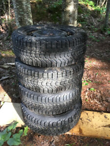 4 Firestone Winterforce Studded Tires on Rims
