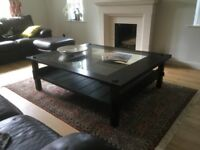 Baladia and Valklein Large Coffee Table with a clear glass inset top.