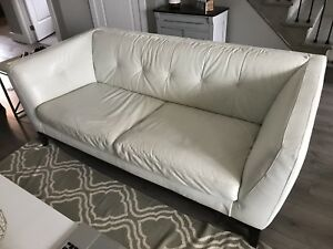 White Natuzzi leather couch dressing