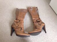 Slim fit size 4 brown knee high boots for sale. Hardly ever worn.