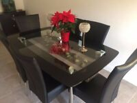 Harvey's Black Glass Dining Room Table and 6 chairs