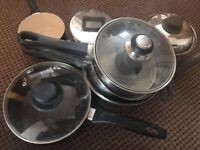 7 sauce pans with lids, all in good condition
