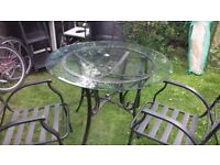 strong garden table with glass top and 3 chairs