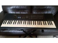 Casio CTK-530 Electronic Piano with a stand