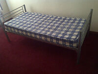 Sturdy Silver bed frames x 2 or assemble into bunk bed