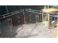 Shot blasted pair of metal gates