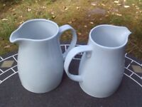 Two white catering jugs