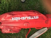 Golf club set in red bag, used but fully useable