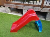 Toddlers play slide