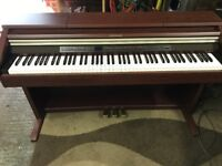 Brown Casio Celviano Digital Piano - hardly been used, good condition