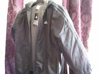 Brand new Adidas black young boys jacket (roughly age 11-14)