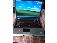 cheap laptop on windows xp, wifi, charger, in perfect working order, a few scratches on the lid.