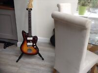 Squire by fender electric guitar Marshall amp and multi effects pedal