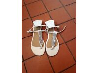 Ladies white jewel ankle strap sandals.