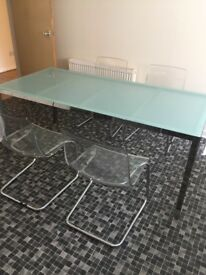Stylish dining table and 4 chairs