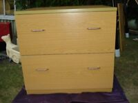 Wooden two drawer filing cabinet.