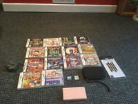 DS lite with 16 games, carrier case, charger and spare stylis pack
