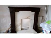 Adam Style Fire surround. Solid marble back plate and hearth. Dark wood surround