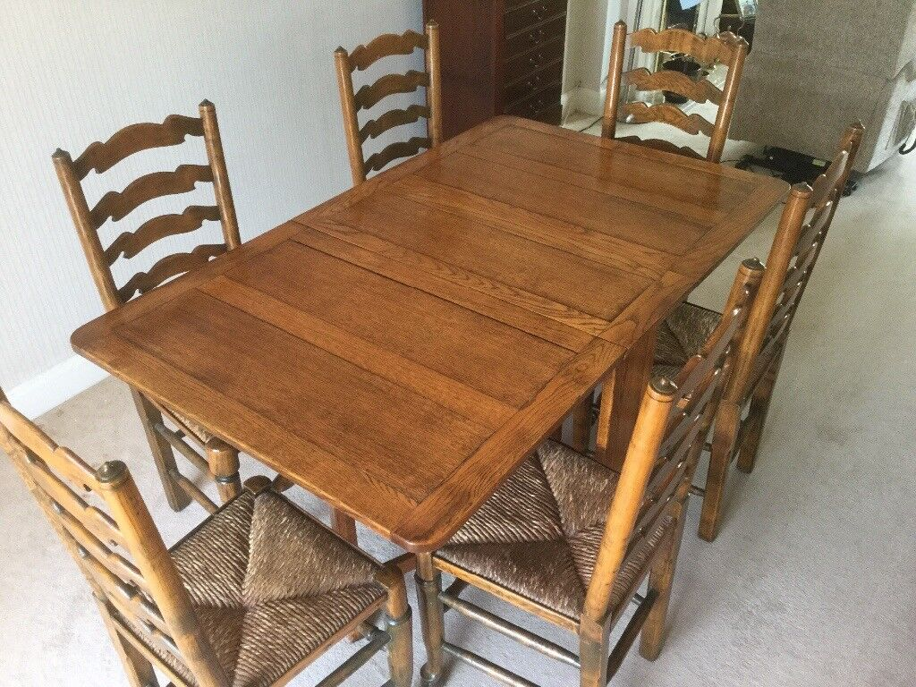 Dining Table and 6 High Backed Chairsin Cyncoed, CardiffGumtree - Traditional drop leaf table (2 leaves) with 6 high backed chairs. All are in excellent condition having been previously stripped down and polyurethane varnished. Buyer to collect please