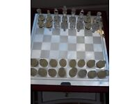Glass chess set with storage in board