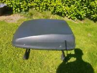 Large roof top box and thule bars
