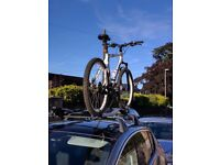 Two excellent condition Thule ProRide 591 bike carrying kits for car roof with locking kits.