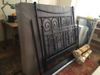 Double black 'iron' bedstead and matress from IKEA.