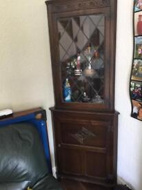 Antiques glass corner cupboard