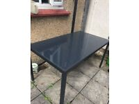 Glass top garden table