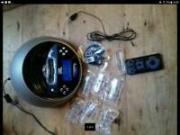 JBL Speaker. Blue LED digital clock. DAB radio and alarm clock. Aux / headphone socket.