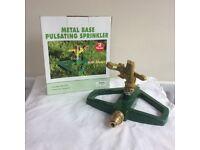 New boxed Greenkey metal base pulsating sprinkler