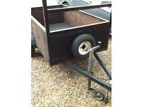 Small trailer with lockable tow hitch